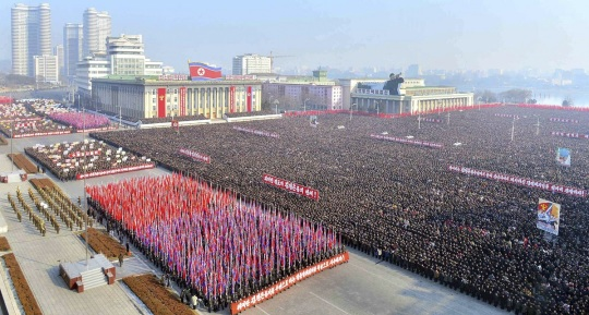 KCNA picture shows people at a rally to exhort the objectives that North Korean leader Kim Jong-Un suggested in his New Year speech, at Kim Il-Sung square